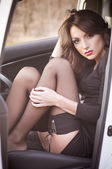 Beautiful lady sitting in a car — Stock Photo