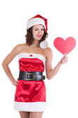 Beautiful young girl in Santa Claus clothes with heart on white background — Stock Photo