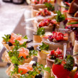 A lot of cold snacks on buffet table, catering — Stock Photo