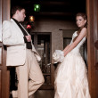Bride and groom on their wedding day in a luxurious restaurant. - 