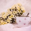 Elegant cup with flowers — Stock Photo