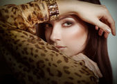 Girl in leopard blouse — Stock Photo