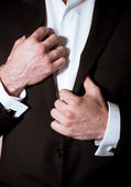 Closeup of a man in black suit with cuff-link — Stock Photo