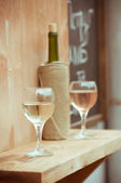 Wine glasses and bottles of wine — Stock Photo