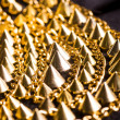Gold plated bracelet with spikes - Stock Photo
