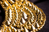 Gold plated bracelet with spikes — Stock Photo