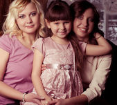 Happy family, young beautiful mother, aunt and her little daughter — Stock Photo
