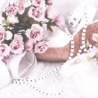 Vintage lace with flowers, shoe and wedding rings on white background — Stok fotoğraf