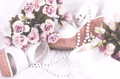 Vintage lace with flowers, shoe and wedding rings on white background — Stock Photo