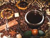 Coffee beans and cinnamon, nuts on background — Stock Photo