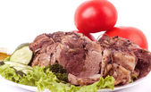 Tasty cold boiled pork with vegetables — Stock Photo