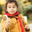 Funny little girl with ice-cream in autumn forest — Stock Photo