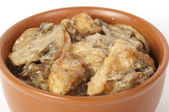 Bowl of roasted chicken — Stock Photo