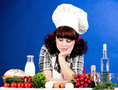Cook woman with food ingredients — Stock Photo