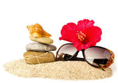 Eautiful exotic shell, crystals and glasses on sand — Stock Photo