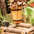 Vintage wooden well and wooden bucket — Stock Photo