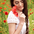 Stock Photo: Beautiful woman in spring garden