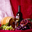 Beautiful composition with wine,grape and barrel on red background — Stock Photo