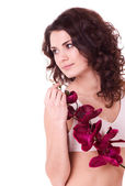 Beauty face of the young woman with flower on white background — Stok fotoğraf
