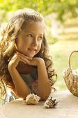 Little happy girl in garden — Stock Photo