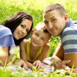 Stock Photo: Happy family lying down in garden