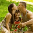 Beautiful young family having fun outdoors — Stock Photo