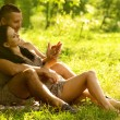 Young couple laying on park lawn — Stock Photo