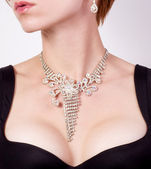 Woman breast with jewelry — Stock Photo