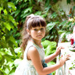 Little happy girl in garden — Stock Photo