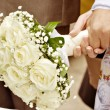Lovers who are just married with bouquet — Stock Photo