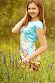 Beautiful young woman in spring garden — Stock Photo