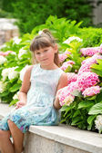 Happy beautiful girl smells flowers — Stock Photo