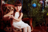 Beautiful little girl with Christmas tree — Stock Photo