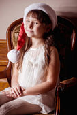 Beautiful little girl in Santa Claus clothes — Stock Photo