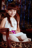 Beautiful little girl with Christmas tree — Stock Photo