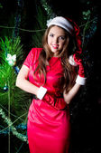 Beautiful young woman in Santa Claus clothes — Stock Photo