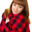 The beautiful young woman in checked plaid — Stock Photo