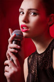 Beauty glamor singer girl n with microphone — Stock Photo