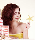Beauty young woman with spa oils — Stock Photo