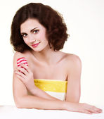Beauty young woman with red soap — Stock Photo