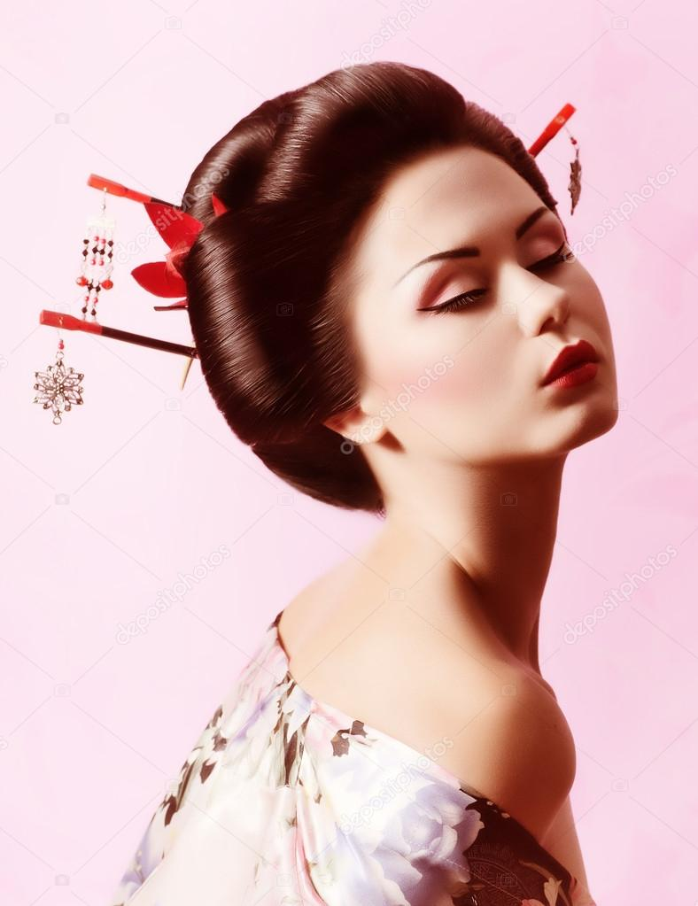 Portrait Of A Japanese Geisha Woman Stock Photo