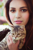 Surprised girl with a little cat — Stock Photo