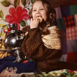 Little girl with samovar and bubliks — Stock Photo