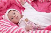 Beautiful baby girl in pink — Stock Photo
