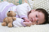 Cute funny infant baby with toy bear — Stock fotografie