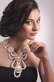 Woman with makeup and with jewelry — ストック写真