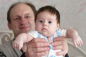 Grandfather with Newborn Baby Girl — Stock Photo