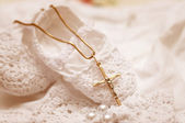 Baby shoes and white dress   for Christening — Stock Photo