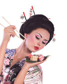 Japanese woman with sushi — Stock Photo
