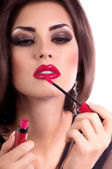 Woman with red gloss lips — Stock Photo